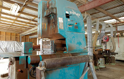 Blue colored old machine used for customising timber products