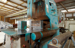 Rusted timber cutting machine kept in a warehouse