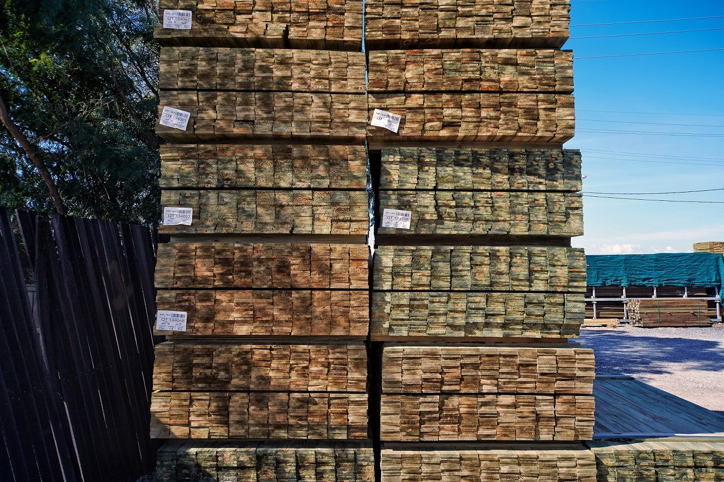 Stack of timbers piled up in a lumber yard