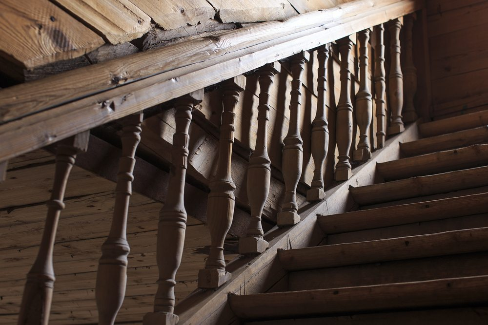 Old, dark timber handrail and balustrade