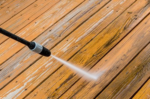 Power washing a wooden deck