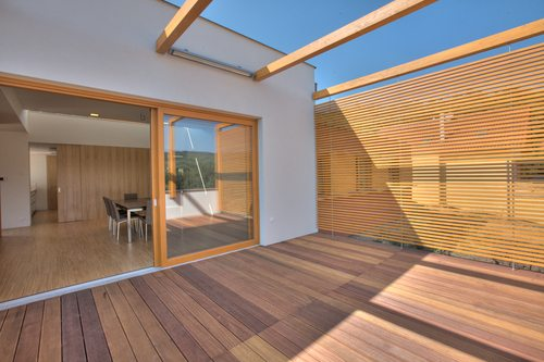 Timber pool deck on modern home terrace with privacy screen