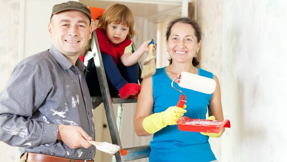 Happy family of three makes repairs at home