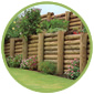 Outdoor wooden fences build on green lawn with green circle